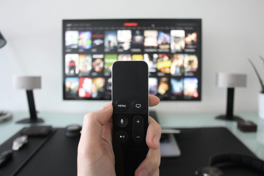 tv remote in hand